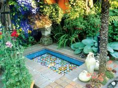 Mosaic Pool In this Mediterranean garden, a Moorish pool is inlaid with an Italian glass mosaic. Ornamental shrubs, grasses, and flowering plants border the water feature. Mediterranean Garden Design, Mediterranean Style, Dream Garden, Garden Art, Garden Pond, Garden Kids, Big Garden, Terrace Garden, Garden Planters