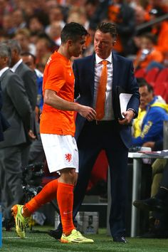 Holland manager Louis van Gaal congratulates Robin van Persie