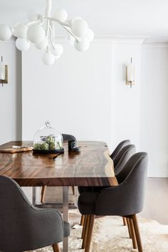 Modern wood slab dining room table paired with charcoal fabric dining chairs. So sleek and clean Design by Rena Cherny Studio