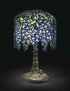 A 'PONY WISTERIA' TABLE LAMP BY TIFFANY, CIRCA 1910