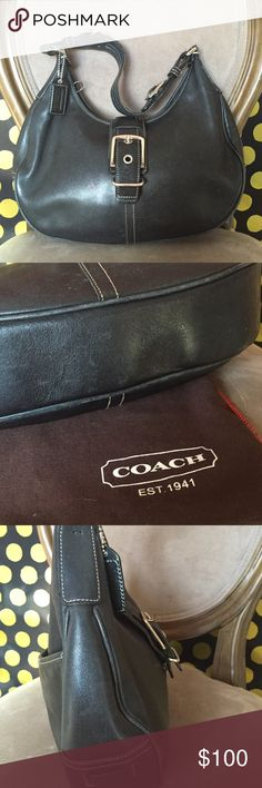 Coach Leather Buckle Hobo Authentic Coach leather buckle hobo in black. Includes original duster bag. Purchased at Coach retail store. Very good used condition. Minor scuffs along bottom edges shown in 2nd photo. The handle was repaired (reattached) and looks like new. The leather pull tab on the zipper fell off, so it's just a loop. Does not detract from function, and you could easily attach a piece of leather or cute keychain to have a zipper pull. Reasonable offers considered. Coach Bags…