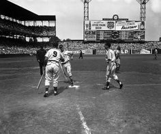 St. Louis Cardinals playing the Brooklyn Dodgers at Sportsman's Park in St. Louis, Missouri. Stan Musial hit a home run in the 4th inning and Enos Slaughter congratulates him. 1946