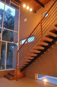 modern residence  rehabilitation (5) Home Living Room, Living Room Designs, Staircase Interior Design, Stainless Steel Staircase, Masonry Paint, Modern Stairs, Modern Glass, Pool Houses, Sliding Glass Door