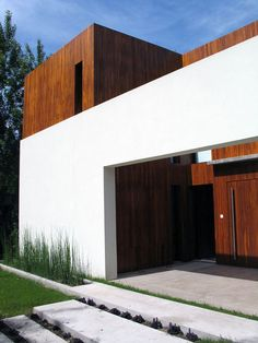 *L-SHAPE PLANE*  in this point of view, the facade of the building specifically the white concrete forms an L-shape in contrast with wood cladding of the house.