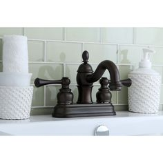 This classic 4-inch center set bathroom faucet features solid brass construction and a matching drain assembly. Upgrade the look and feel of your bathroom with this attractive faucet.