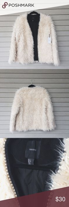"""F21 Shaggy Faux Fur Coat Channel a 70s starlet in this 🔥 shaggy faux fur coat from Forever 21! Tagged L but could maybe fit M for oversized look. Jacket is a beautiful cream/oatmeal color and perfect for chillier weather. Has a row of silver embellishments down the front (pic 3) but can prob be removed easily. 2 hidden pockets in front & lightly lined. #shag #f21 #pennylane #shearling #decade #trend --- Measurements: 37-38"""" bust & shoulders; 27"""" long; wrist opening 8"""" around Forever 21…"""