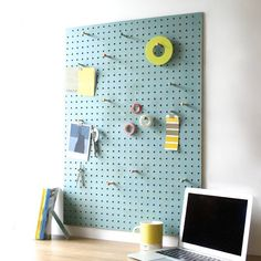 blue pegboard with wooden pegs, large by block | notonthehighstreet.com