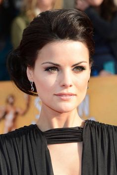 "Jaimie Alexander-- ""These warm smoky eyes and pale peach lips provide an approachable but steamy look when walking down the aisle,"""