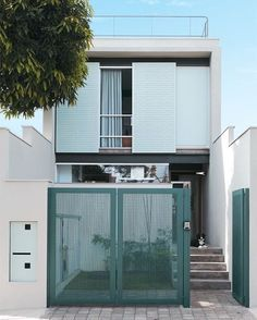 Facade of Narrow House with Green Gate Small House Design, Modern House Design, Minimalist House Design, Facade Design, Exterior Design, Fence Design, Compact House, Narrow House, Minimal Home