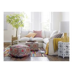 Bright, airy room from Crate & Barrel. I particularly like the Zola rug, but I neeeed a suzani ottoman.
