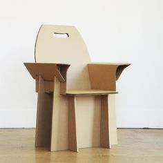 Recycled cardboard chair by NuBe Green. Cardboard Chair, Cardboard Recycling, Diy Cardboard Furniture, Cardboard Box Crafts, Cardboard Playhouse, Cardboard Design, Paper Furniture, Cardboard Sculpture, Cardboard Paper