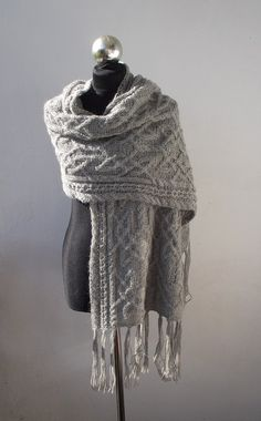 This is what I should make with my grandmother's unfinished aran knitting...I have no idea what she was intending!
