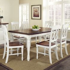 Seven-piece wood dining set with dining table and six double X-back side chairs.   Product: Dining table and 6 chairsCon...