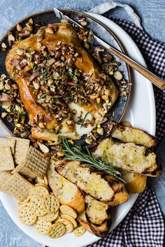 Baked Brie wheel with mixed nuts, rosemary and honey