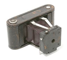 The Folding Pocket Kodak was a folding camera made by Eastman Kodak Co. Ltd., Rochester, from 1897-98. Frank Brownell was its designer. It took 2 1/4×3 1/4 exposures on Kodak 105 film rolls and had an Achromatic f/11 lens. The price was $10. The camera model had been renamed to Folding Pocket Kodak No. 1 to distinguish it from the newer Folding Pocket Kodak No. 1A. The No. 1 stood for the smallest format in Kodak's rollfilm exposure format portfolio: 1, 1A, 2, 2A, 3, and 3A.