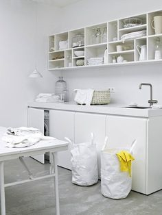 Steal This Look: The Clean White Laundry Room (Remodelista: Sourcebook for the Considered Home) White Laundry Rooms, Laundry In Bathroom, Ikea Laundry, Hidden Laundry, Laundry Shelves, Cubby Shelves, Small Laundry, Shelf, Laundry Room Organization