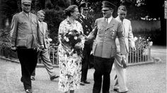 Adolf talking with Winifred Wagner in the park of the Wahnfried Villa in Bayreuth in summer 1937. Winifred Wagner was the daughter-in-law of Richard Wagner
