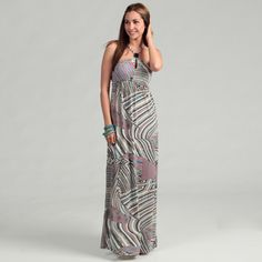 @Overstock - A colorful tribal print highlights this white maxi dress from Jessica Simpson. Beaded accents, an empire waist and sleeveless design finish this fashionable dress.   http://www.overstock.com/Clothing-Shoes/Jessica-Simpson-Juniors-Papyrus-Maxi-Dress/6579380/product.html?CID=214117 $49.99