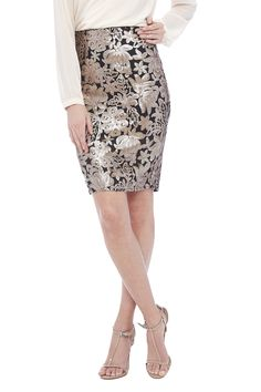 Gold and tan sequined skirt with black underlining, a slit in the back, and a back zipper closure.   Gold/Tan Printed Skirt by Nuage. Clothing - Skirts - Pencil Connecticut