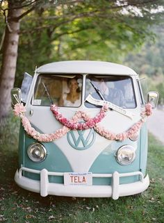 Do you want your wedding party along with you as you move from the ceremony to the reception? Well, then you'll probably need a bus to handle that. But if it's as adorable as this pastel vintage VW van, you'll have trouble counting the number of people that want to catch a ride in this wedding getaway car.
