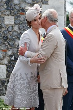 Prince Charles embraced his daughter-in-law (pictured), Kate, and his son, Prince William ahead of the commemoration today