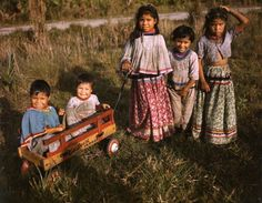 A group of Seminole children playing outside, Brighton Reservation, Florida, United States, photograph by Joseph Janney Steinmetz. Native American Children, Native American Indians, Native Americans, Vintage Florida, Old Florida, Brighton, Seminole Indians, Seminole Florida, Indian Tribes
