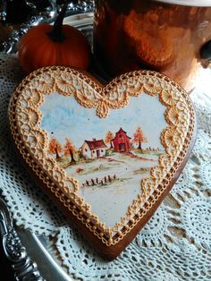 Gingerbread heart cookie intricately hand piped ,fall,scene