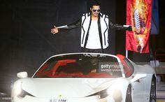 Indian actor and dancer, Varun Dhawan arrives in a Ferrari luxury car to perform on stage during the Arab Indo Bollywood Awards ceremony early on May 30, 2015 in Dubai.