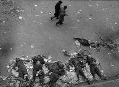 """historicaltimes: """" Two Hungarian revolutionaries walk past the bodies of Soviet secret policemen killed during the Hungarian Revolution, """" World Of Tanks, Tumblr, Budapest Hungary, Vietnam War, Cold War, Pictures Images, Eastern Europe, In This Moment, Historia"""