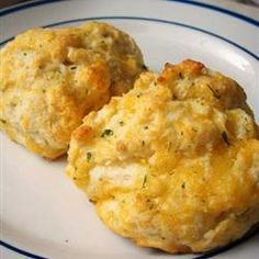4 cups Bisquik  1 cup shredded cheddar cheese  1 1/3 c water  1/2 c melted butter  1 tsp garlic powder  1/4 tsp salt  1/4 tsp onion powder  1/4 tsp dried parsley   Combine Bisquik, cheese & water in a bowl and mix until dough is firm.  Scoop dough on to greased baking sheet.  Bake at 375 for 10 to 12 mins. Combine other ingredients & brush on biscuits after immediately removed from oven.
