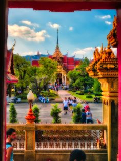 tourist walking about view from window Wat Chalong Thailand