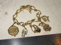 I'll never stop loving you.  SALE Vintage Monet Goldtone Charm Bracelet by SpoiledGirls on Etsy, $30.00