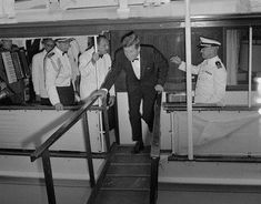 JFK getting off a ship or yacht