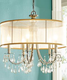This isn't grandma's chandelier: the fashion-forward design of the Savannah Crystal Chandelier combines a translucent shade crafted from high-quality silk fabric with teardrop almond crystals.