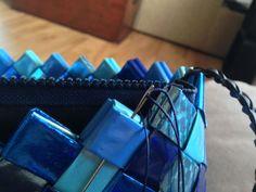 Sy lynlås med fór i tasken