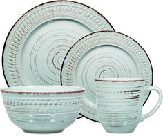 Boasting distressed blue tones and chocolate brown patterns, the Aqua dinnerware set from Home Essentials brings rustic-chic to the table for a cool accent to casual dining and entertaining. | Farmhouse kitchen, rustic decor (affiliate)