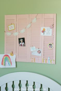 Repurposed Shutters!! Makes a great spot to hang Kid Art!      Paint shutters black or Brown and use silver clips for B photos in living room..     Paint any cool color and hang in hallway for mail, grocery lists, homework..