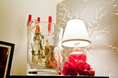 small details in unexpected spaces make for stylish surprises.  a sparkly chandelier christmas ornament dangles inside the glass ice bucket atop the bar.  see other shoe string budget decorating tips: http://www.houzz.com/ideabooks/9618710/list/My-Houzz--Color-and-Pattern-Make-a-Manhattan-Apartment-Sing