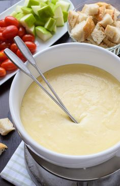 The best cheese fondue recipe. So easy and your friends will be totally impressed! Includes tips and what to dip in cheese fondue too