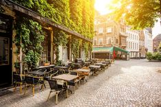 Street view with cafe terrace during the morning in Antwerpen city in Belgium, Adobe Stock Cafe Tables, Restaurant Tables, Places To Travel, Places To Go, European Cafe, Hostel, Around The Worlds, Street View, Patio