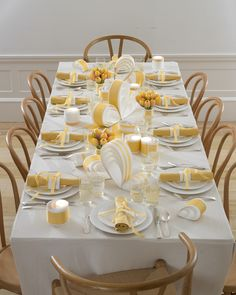 Lend a dazzling freshness to the table with these vivid yellow paper loop-de-loop centerpieces.