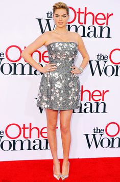 Kate Upton wears a Dolce and Gabbana silver mini dress with Giuseppe Zanotti heels at the L.A. premiere of The Other Woman