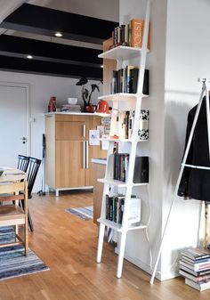 Lovely leaning bookshelf - I could really use this piece.