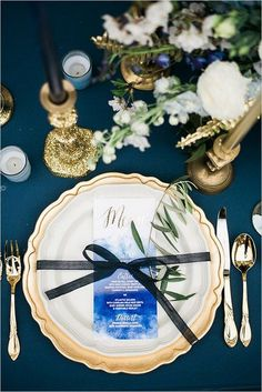 blue white and gold place setting / http://www.deerpearlflowers.com/navy-blue-and-white-wedding-ideas/2/