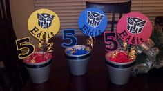 Transformers centerpieces for my sons birthday 5th Birthday Party Ideas, Fourth Birthday, Birthday Board, Boy Birthday, Birthday Centerpieces, Birthday Decorations, Iron Man Party, Rescue Bots Birthday, Transformers Birthday Parties