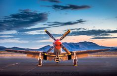 Stadium lights shine on this P-51 early in the morning making it glow in the pre dawn light.  National Championship Air Races, Reno.