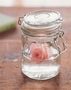 as simple as a single rose floating in a mason jar....