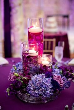 Purple wedding inspiration. 4 vase centerpiece -- 3 cylinders inside a low, wide, round vase.