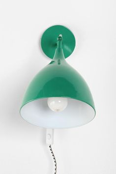 Industrial Sconce - the vibrant, green-colored sconce  adds more than just light to a room, it adds character and color!