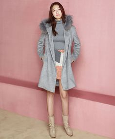 Love the hit of salmon & white skirt paired  with gray top and coat.